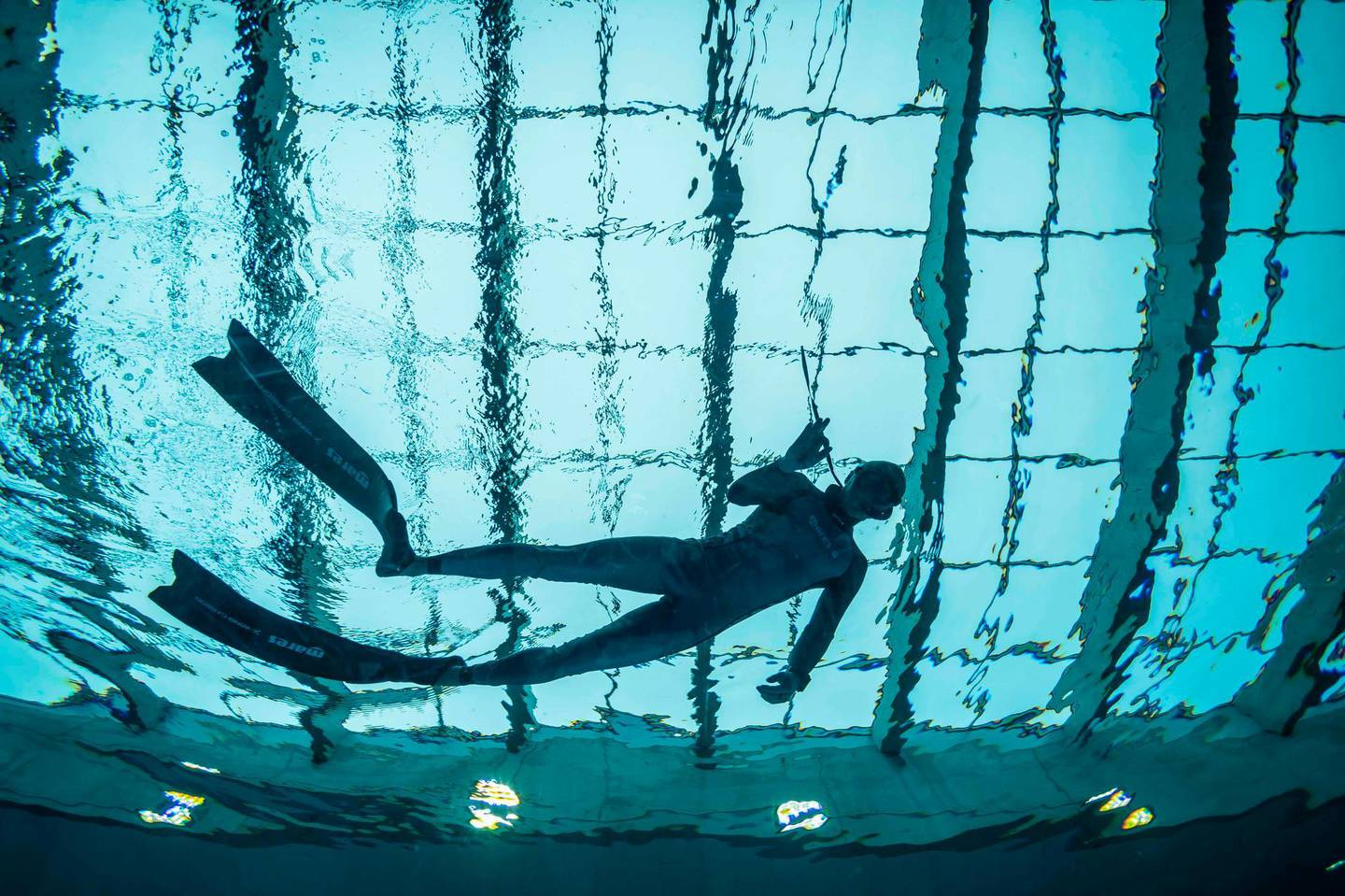 A diver is seen in the deepest pool in the world with 45.5-metre (150-foot) located in Mszczonow about 50 km from Warsaw, November 21, 2020.  The complex, named Deepspot, even includes a small wreck for scuba and free divers to explore. It has 8,000 cubic metres of water -- more than 20 times the amount in an ordinary 25-metre pool.  / AFP / Wojtek RADWANSKI / TO GO WITH AFP STORY