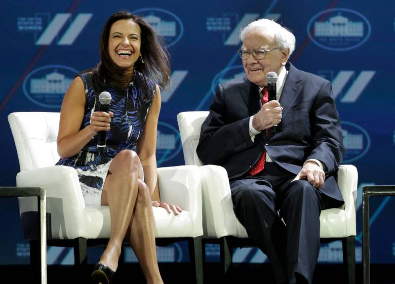 Dina Habib Powell, Head of Goldman Sachs' Impact Investing Business and President of the Goldman Sachs Foundation, Goldman Sachs, reacts as Warren Buffett, Chairman & CEO, Berkshire Hathaway, speaks at the White House Summit on the 'United State of Women' in Washington on June 14, 2016. (Photo by YURI GRIPAS / AFP)