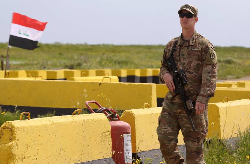 (FILES) In this file photo taken on March 26, 2020, a US soldier walks at the Qayyarah air base, where US-led troops in 2017 had helped Iraqis plan out the fight against the Islamic State in nearby Mosul in northern Iraq, before a planned US pullout. The United States agreed in talks on April 7, 2021 with Iraq to remove all remaining combat forces deployed to fight Islamic State extremists, although US forces will still provide training. / AFP / AHMAD AL-RUBAYE
