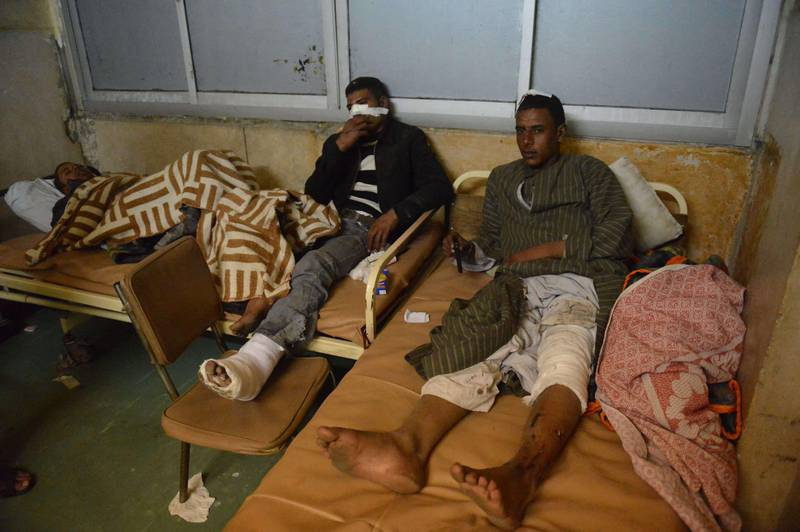 Injured soldiers lie on beds at a hospital after a train carrying conscripts derailed in the Giza neighbourhood of Badrasheen, about 40 kilometres south of Cairo, on January 15, 2013, killing 19 people and wounding 107. The accident is the latest in a string of transport disasters plaguing Egypt, and comes just two weeks after a new transport minister, Hatem Abdul Latif was appointed. AFP PHOTO / KHALED DESOUKI  *** Local Caption ***  260274-01-08.jpg