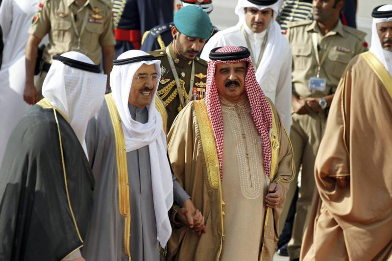 Emir of Kuwait, Sabah Al-Ahmad Al-Jaber Al-Sabah is received by Bahrain's King Hamad bin Isa Al Khalifa upon his arrival at Sakhir VIP airport to attend the Gulf Cooperation Council's (GCC) 37th Summit, Bahrain, December 6, 2016. REUTERS/Hamad I Mohammed