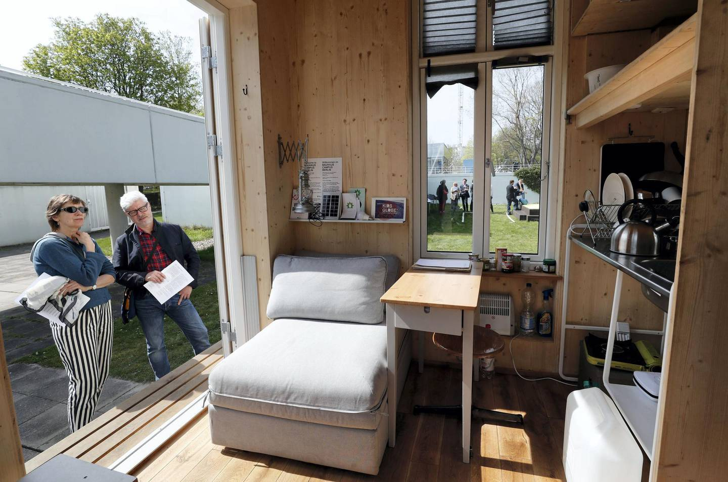Mandatory Credit: Photo by Felipe Trueba/EPA/Shutterstock (8594904a)People look at the interior of a home unit, a small mobile living space, part of a project of the Tiny House University at the Bauhaus Archive Museum of Design in Berlin, Germany, 10 April 2017. The Bauhaus Campus is an artistic experiment composed of 'Tiny Houses', mobile architectural structures no larger than a parking space, approaching topics such as minimal living space, co-working or study programs for refugees.Tiny House project in Berlin, Germany - 10 Apr 2017