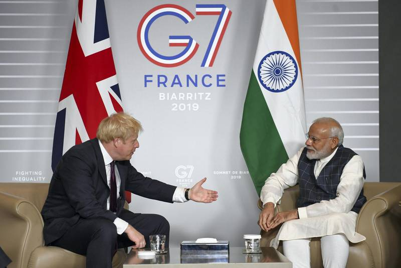 BIARRITZ, FRANCE - AUGUST 25: British Prime Minister Boris Johnson (L) meets Prime Minister of India Narendra Modi for bilateral talks during the G7 summit on August 25, 2019 in Biarritz, France. The French southwestern seaside resort of Biarritz is hosting the 45th G7 summit from August 24 to 26. High on the agenda will be the climate emergency, the US-China trade war, Britain's departure from the EU, and emergency talks on the Amazon wildfire crisis. (Photo by Stefan Rousseau - Pool/Getty Images)