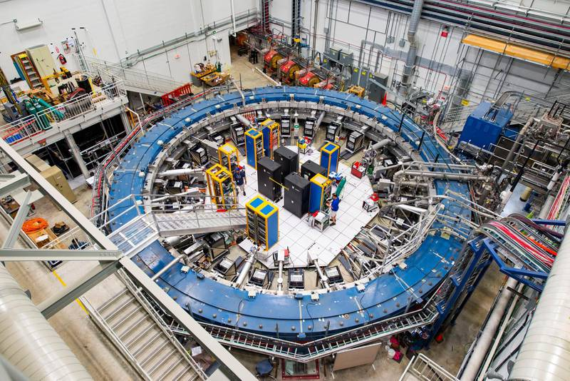 This August 2017 photo made available by Fermilab shows the Muon g-2 ring at the Fermi National Accelerator Laboratory outside of Chicago. It operates at -450 degrees Fahrenheit (-267 degrees Celsius) to detect the wobble of muons as they travel through a magnetic field. Preliminary results published in 2021 of experiments from here and the CERN facility in Europe challenge the way physicists think the universe works,a prospect that has the field of particle physics both baffled and thrilled. (Reidar Hahn/Fermilab via AP)
