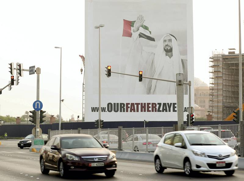 Abu Dhabi, United Arab Emirates, August 06, 2017: Our father Zayed poster with traffic going past on Thursday, Aug. 06, 2017, The Corniche, Abu Dhabi. Chris Whiteoak The National