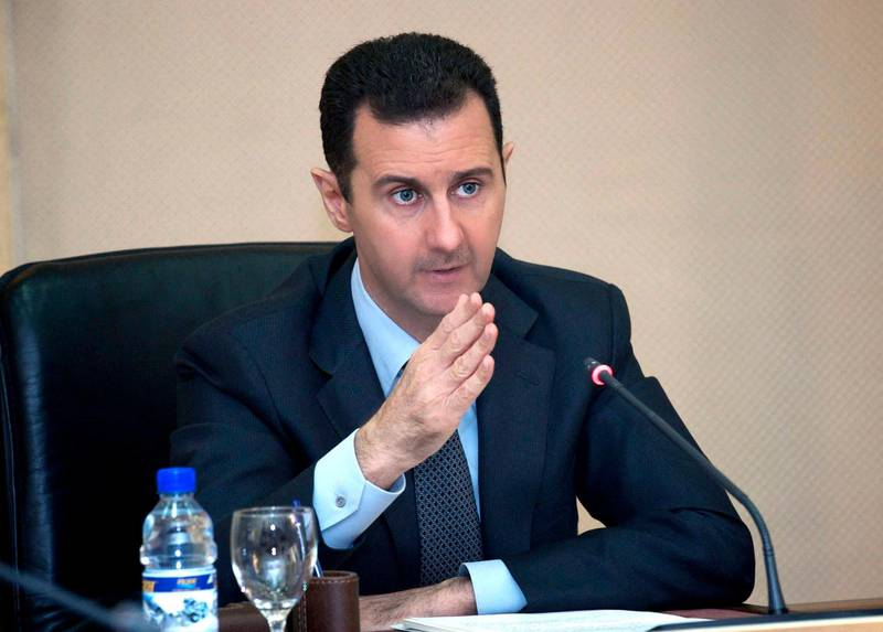 """A handout picture released by the official Syrian Arab News Agency (SANA) on February 12, 2013, shows Syria's President Bashar al-Assad heading a cabinet meeting in the Presidential palace in Damascus. The death toll from the Syria civil war is nearing 70,000, UN rights chief Navi Pillay said Tuesday as she again condemned the UN Security Council's failure to agree action on the conflict. AFP PHOTO/HO/SANA == RESTRICTED TO EDITORIAL USE - MANDATORY CREDIT """"AFP PHOTO/HO/SANA"""" - NO MARKETING - NO ADVERTISING CAMPAIGNS - DISTRIBUTED AS A SERVICE TO CLIENTS == (Photo by - / SANA / AFP)"""