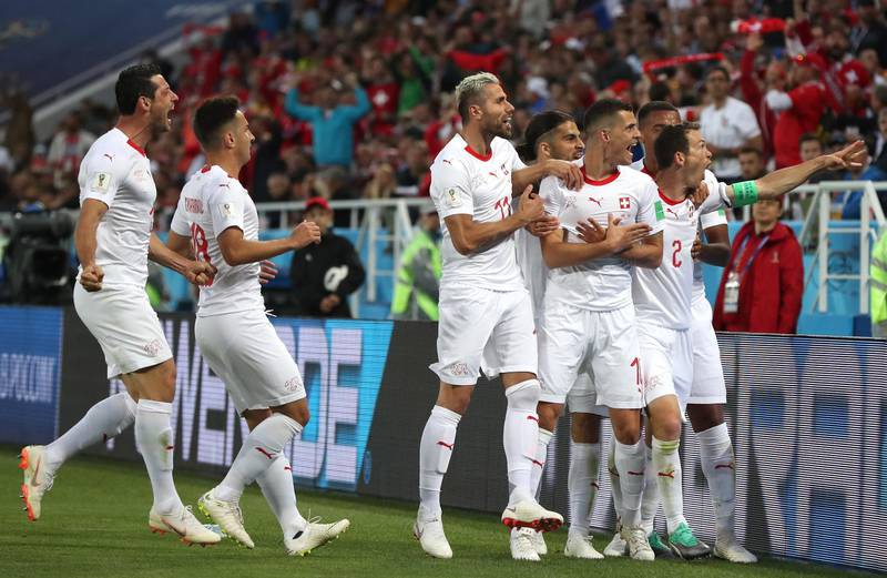 epa06831855 Granit Xhaka (C-R) of Switzerland celebrates with teammates after scoring the equalizer during the FIFA World Cup 2018 group E preliminary round soccer match between Serbia and Switzerland in Kaliningrad, Russia, 22 June 2018.  (RESTRICTIONS APPLY: Editorial Use Only, not used in association with any commercial entity - Images must not be used in any form of alert service or push service of any kind including via mobile alert services, downloads to mobile devices or MMS messaging - Images must appear as still images and must not emulate match action video footage - No alteration is made to, and no text or image is superimposed over, any published image which: (a) intentionally obscures or removes a sponsor identification image; or (b) adds or overlays the commercial identification of any third party which is not officially associated with the FIFA World Cup)  EPA/MARTIN DIVISEK   EDITORIAL USE ONLY