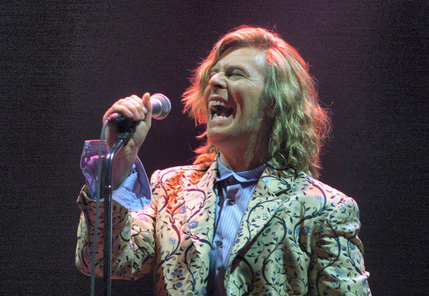 Rock Star David Bowie headlines at the Glastonbury Festival 2000 June 25. Day three of the festival saw a performance by rock legend Bowie playing for the first time at Glastonbury since 1971, when the event was only in its second year.  DC/CLH/