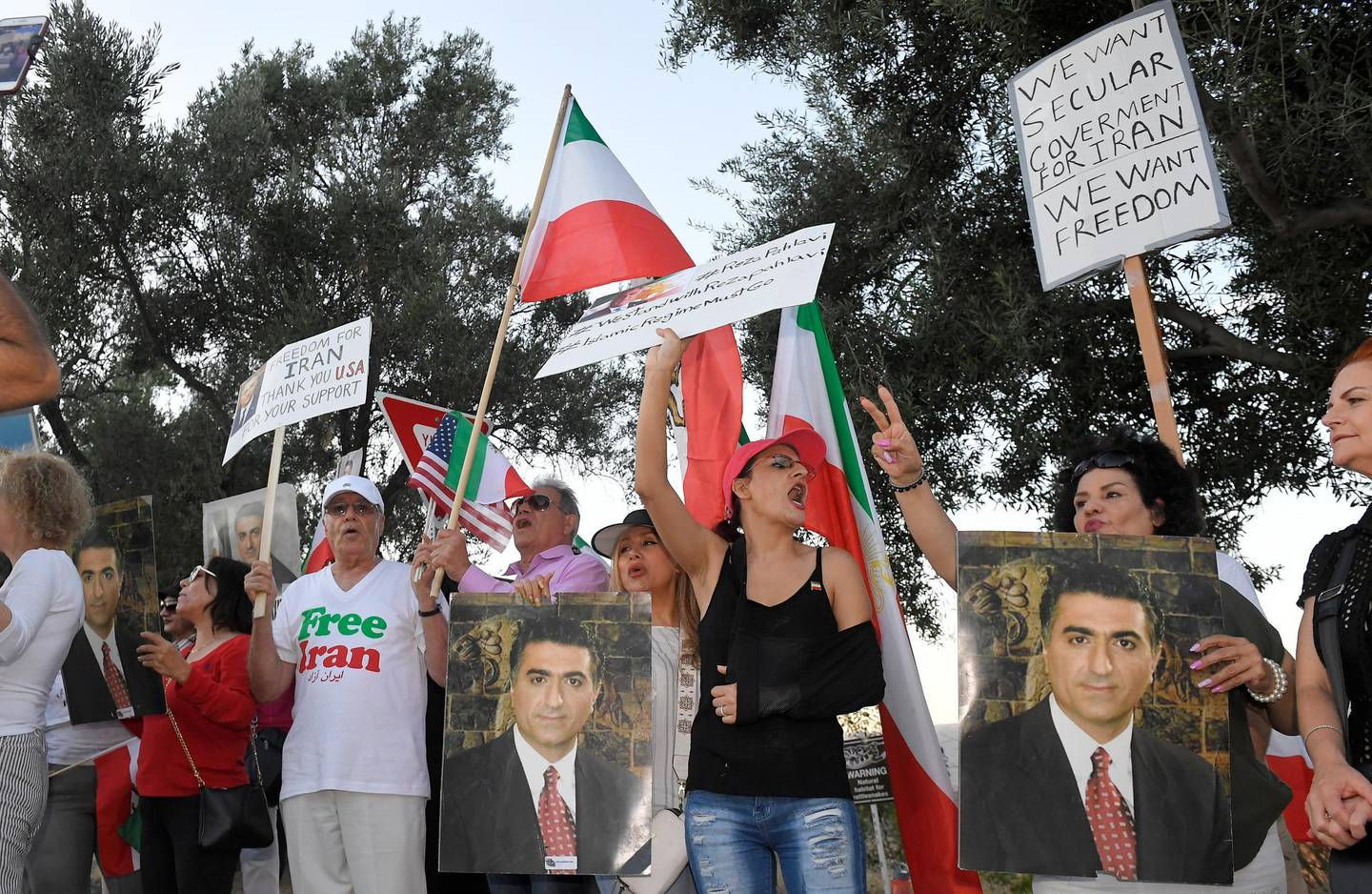 Protesters against the current Iranian regime stand outside the Ronald Reagan Presidential Library and Museum where U. S. Secretary of State Mike Pompeo was speaking Sunday, July 22, 2018, in Simi Valley, Calif. (AP Photo/Mark J. Terrill)