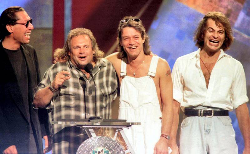 Members of the band Van Halen (L-R) Alex Van Halen, Michael Anthony, Eddie Van Halen are reunited with former lead singer David Lee Roth (R) on stage at the 1996 MTV Video Music Awards in New York on September 4.