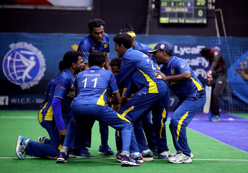 Dubai, United Arab Emirates - September 19th, 2017: Sri Lanka celebrate another wicket during the game between the UAE v Sri Lanka in the W.I.C.F Indoor cricket world cup 2017. Tuesday, Sept 19th, 2017, Insportz, Al Quoz, Dubai. Chris Whiteoak / The National