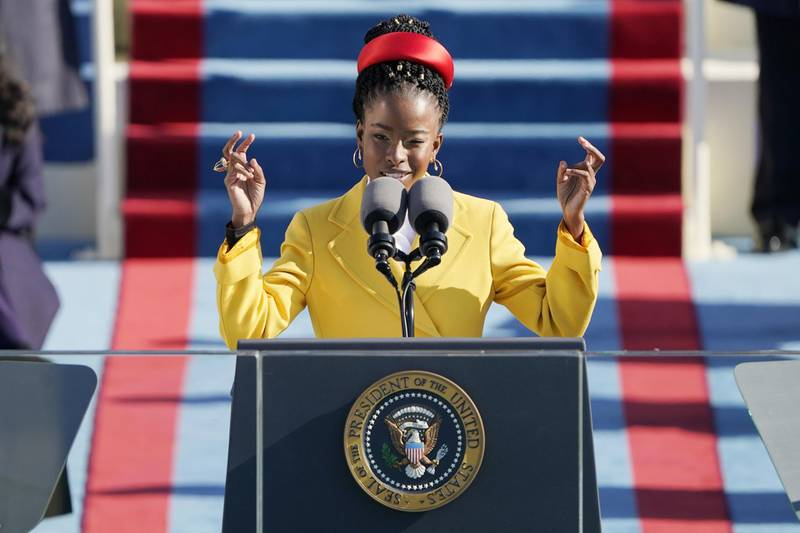 American poet Amanda Gorman reads a poem during the 59th presidential inauguration in Washington, D.C., U.S., on Wednesday, Jan. 20, 2021. Biden will propose a broad immigration overhaul on his first day as president, including a shortened pathway to U.S. citizenship for undocumented migrants - a complete reversal from Donald Trump's immigration restrictions and crackdowns, but one that faces major roadblocks in Congress. Photographer: Patrick Semansky/AP Photo/Bloomberg