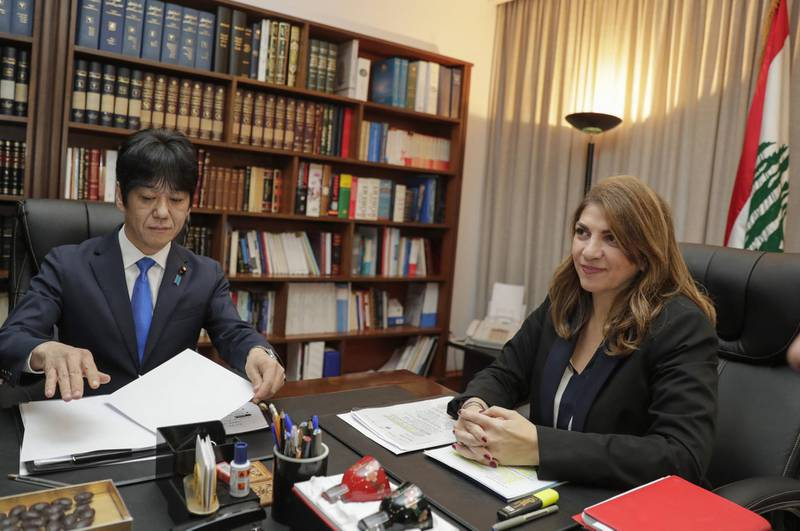Lebanese Justice Minister Marie Claude Najm meets with Japan's deputy Justice Minister Hiroyuki Yoshiie in the capital Beirut, on March 2, 2020, to discuss the case of former Nissan Chairman Carlos Ghosn, currently a fugitive in his native Lebanon. - The 65-year-old businessman, for years venerated in Japan for turning around once-ailing Nissan, fled while awaiting trial on charges including allegedly under-reporting his compensation to the tune of $85 million. His shock arrival in Lebanon in December was the latest twist in a story which prompted outrage from the Japanese government as well as from Nissan. (Photo by ANWAR AMRO / AFP)