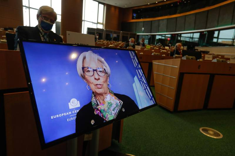 epa09081131 Christine Lagarde, President of the European Central Bank, shown on screen as she takes part in a monetary dialogue by a videoconference during a Committee on Economic and Monetary Affairs at the European Parliament in Brussels, Belgium, 18 March 2021.  EPA/STEPHANIE LECOCQ Committee on Economic and Monetary Affairs