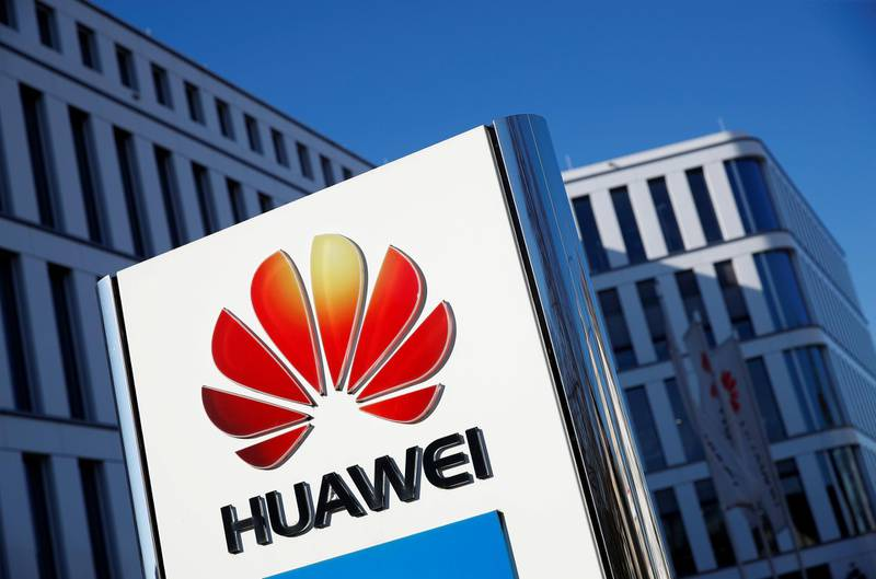 FILE PHOTO: The logo of Huawei Technologies in front of the German headquarters of the Chinese telecommunications group in Duesseldorf, Germany, February 18, 2019.  REUTERS/Wolfgang Rattay/File Photo