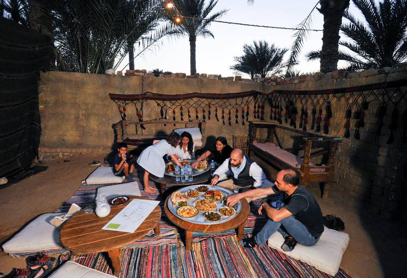 Tourists enjoy a meal made by Saqqara residents to improve their living conditions in thier village, in Giza, Egypt, April 27, 2021. Picture taken April 27, 2021. REUTERS/Shokry Hussien