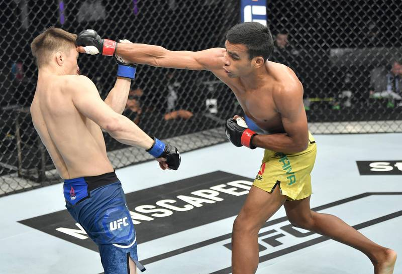 ABU DHABI, UNITED ARAB EMIRATES - JULY 12: (R-L) Raulian Paiva of Brazil punches Zhalgas Zhumagulov of Kazakhstan in their flyweight fight during the UFC 251 event at Flash Forum on UFC Fight Island on July 12, 2020 on Yas Island, Abu Dhabi, United Arab Emirates. (Photo by Jeff Bottari/Zuffa LLC)