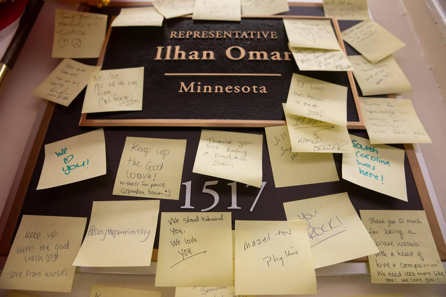 epa07364455 Post-it Notes of support for Democratic Representative of Minnesota Ilhan Omar hang on her office nameplate at her Longworth House Office Building in Washington, DC, USA, 12 February 2019. Omar apologized for statements condemned as anti-semitic by both Democratic and Republican colleagues.  EPA/ERIK S. LESSER