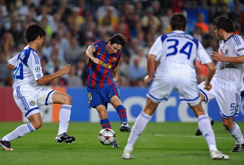 BARCELONA, SPAIN - SEPTEMBER 29:   Lionel Messi (2nd L) of Barcelona scores his sides opening goal past Leandro Almeida (L), Yevgen Khacheridi (2nd R) and Ognjen Vukojevic of Dynamo Kiev during the Champions League group F match between Barcelona and Dynamo Kiev at the Camp Nou Stadium on September 29, 2009 in Barcelona, Spain.  (Photo by Jasper Juinen/Getty Images)