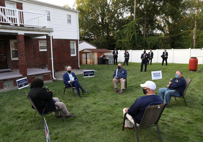 Democratic U.S. presidential nominee and former Vice President Joe Biden meets with steel workers at a backyard during a visit to Detroit, Michigan, September 9, 2020. REUTERS/Leah Millis