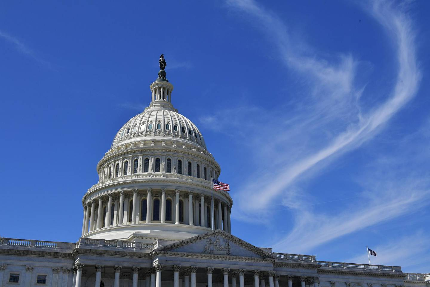 (FILES) In this file photo the dome of the US Capitol is seen in Washington, DC on March 27, 2019. US lawmakers appeared on track December 20, 2020 to pass a roughly $900 billion Covid-19 relief package for millions of Americans, after Democrats and Republicans reached a compromise on the future spending powers of the Federal Reserve. The package is expected to include aid for vaccine distribution and logistics, extra jobless benefits of $300 per week, and a new round of $600 stimulus checks -- half the amount provided in checks distributed last March under the CARES Act.  / AFP / MANDEL NGAN