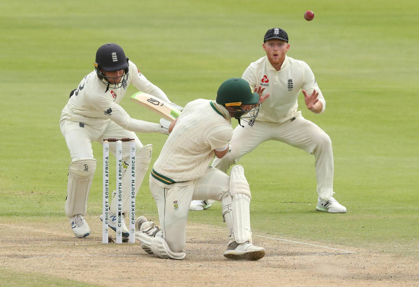 Cricket - South Africa v England - Second Test - PPC Newlands, Cape Town, South Africa - January 6, 2020   South Africa's Pieter Malan in action as England's Ben Stokes reacts   REUTERS/Mike Hutchings