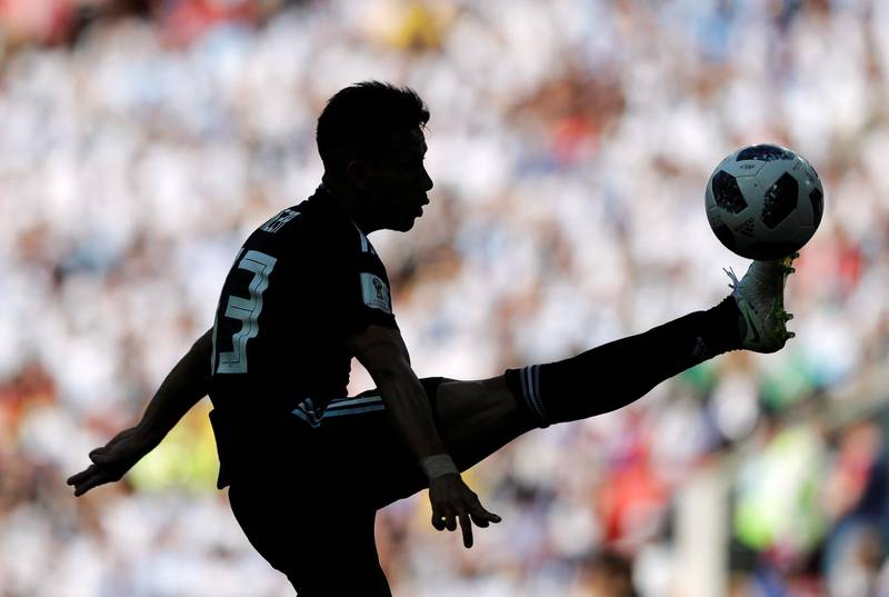 Argentina's Maximiliano Meza is silhouetted when controlling a ball during the group D match between Argentina and Iceland at the 2018 soccer World Cup in the Spartak Stadium in Moscow, Russia, Saturday, June 16, 2018. (AP Photo/Matthias Schrader)