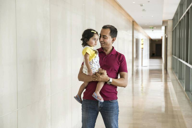 DUBAI, UNITED ARAB EMIRATES - MAY 12, 2018. Manish Punjabi with his 18 month daughter, Mira, at his home in The Greens.(Photo by Reem Mohammed/The National)Reporter: ALICE HAINESection: BZ