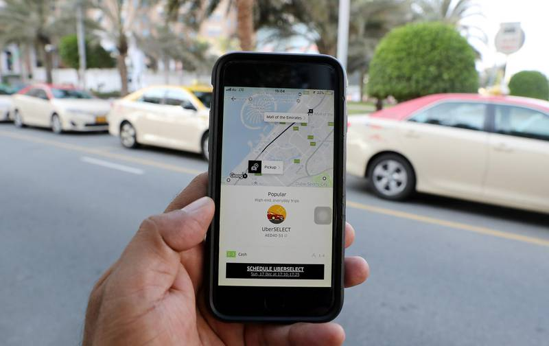 DUBAI , UNITED ARAB EMIRATES , DEC 17  – 2017 :- One of the person using Uber app to book the taxi in Dubai.  (Pawan Singh / The National)
