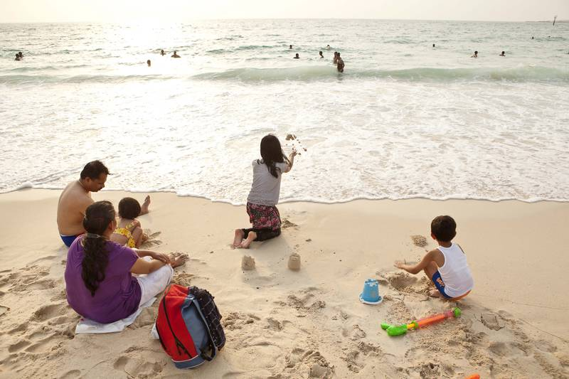 June 30. The Thomakut family enjoy the afternoon surf on Jumeirah open beach on the first day of the long weekend. June 30, Deira, Dubai, United Arab Emirates (Photo: Antonie Robertson/The National)