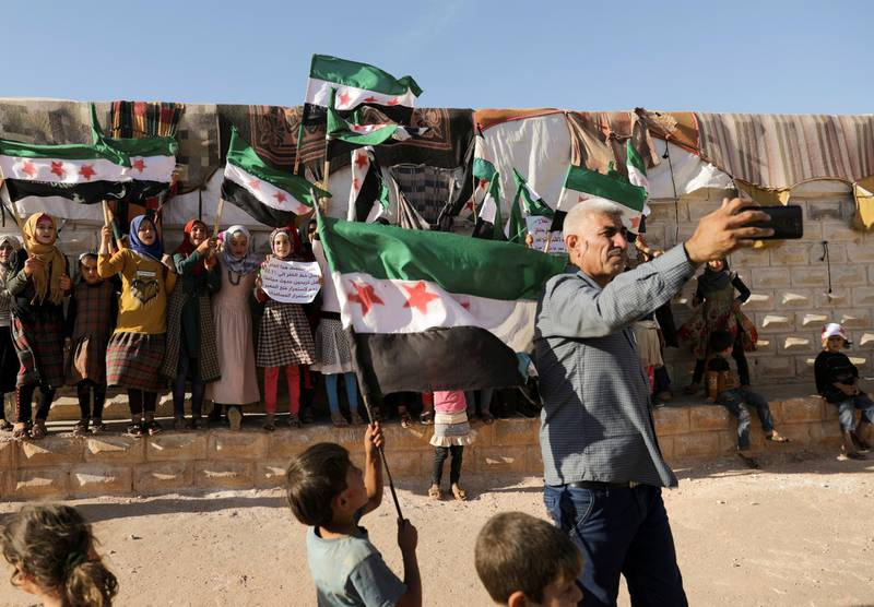 Abdelsalam al-Youssef, director of Teh displaced camp in northern Idlib, takes a selfie during a protest against the closure of Bab al-Hawa crossing in the opposition-held Idlib, Syria June 7, 2021. Picture taken June 7, 2021. REUTERS/Khalil Ashawi