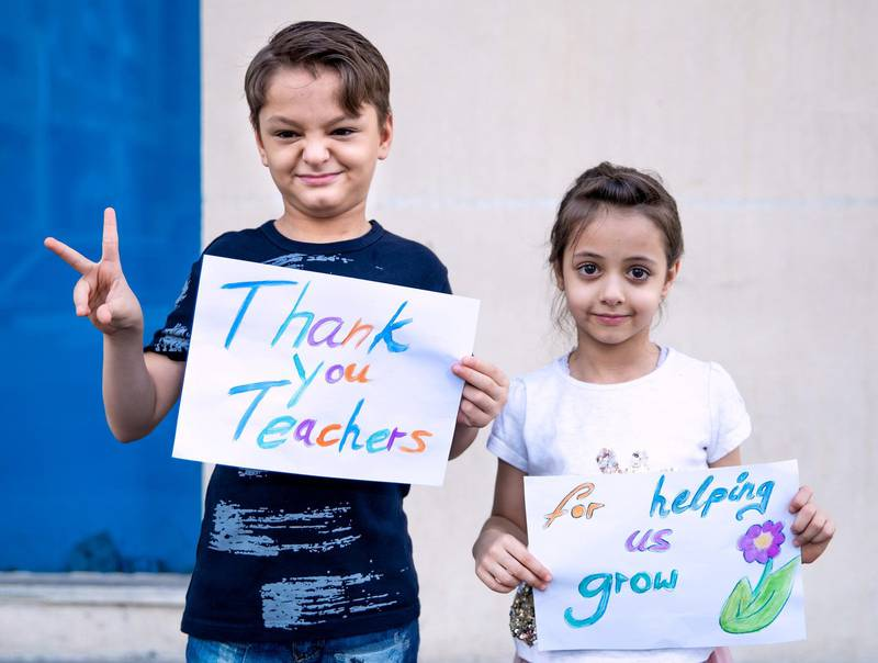 """Abu Dhabi, United Arab Emirates - Reporter: N/A. Photo Project. Missing our teachers. Zayed aged 8 and Maya aged 5 Ewis who are German Egyptian and their teachers are Ms Angelica, Ms Abeer, Ms Insiya and Ms Qudisia at Emirates Private School. Zayed said ÒDear Teachers, I want to thank you all for you patient with us, while e-learning. It was for all of us a new situation. I am happy to see you all next year. Stay safe.Ó Maya said """"I miss you so much. I am waiting to see you all back. Thank you for your help always. Miss you."""" Monday, June 22nd, 2020. Abu Dhabi. Victor Besa / The National"""