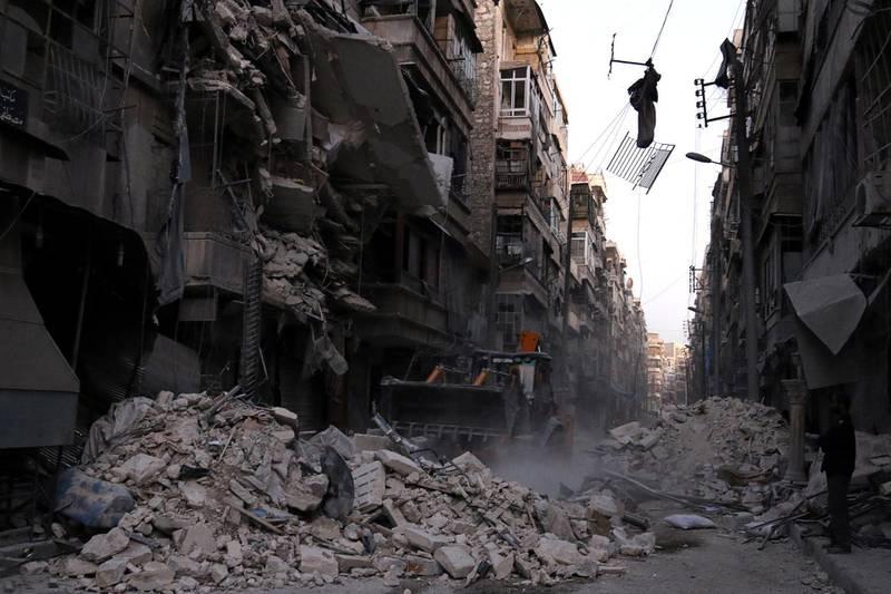Civil Defense members work at a site hit by an airstrike in the rebel-held al-Shaar neighbourhood of Aleppo, Syria, September 27, 2016. REUTERS/Abdalrhman Ismail