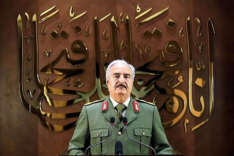 """(FILES) This file image grab taken from a video published by the War Information Division of military strongman Khalifa Haftar's self-proclaimed Libyan National Army (LNA) on April 28, 2020 shows Haftar giving a speech, saying he had """"a popular mandate"""" to govern the country, declaring a key 2015 political deal over and vowing to press his assault to seize Tripoli. Ten years after Libya's NATO-backed uprising ousted and killed dictator Moamer Kadhafi, the country remains wracked by conflict and chaos, its population bled dry despite the nation's vast oil wealth. A UN-led process has lifted cautious hopes that the latest fragile ceasefire will bring a lasting peace, but, for now, Libya is split in two by rival camps with their own militias, mercenaries and foreign backers. - RESTRICTED TO EDITORIAL USE - MANDATORY CREDIT """"AFP PHOTO / LNA WAR INFORMATION DIVISION"""" - NO MARKETING NO ADVERTISING CAMPAIGNS - DISTRIBUTED AS A SERVICE TO CLIENTS  / AFP / LNA War Information Division / - / RESTRICTED TO EDITORIAL USE - MANDATORY CREDIT """"AFP PHOTO / LNA WAR INFORMATION DIVISION"""" - NO MARKETING NO ADVERTISING CAMPAIGNS - DISTRIBUTED AS A SERVICE TO CLIENTS"""