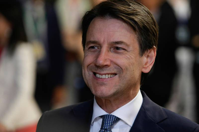 Prime Minister of Italy Giuseppe Conte speaks to the press before leaving the first day of a European Union leaders' summit focused on migration, Brexit and eurozone reforms in Brussels on June 29, 2018. European Union leaders reached a crucial deal on steps to tackle migration during all-night talks on June 29 after resolving a bitter row with Italy's hardline new premier. / AFP / Aris Oikonomou