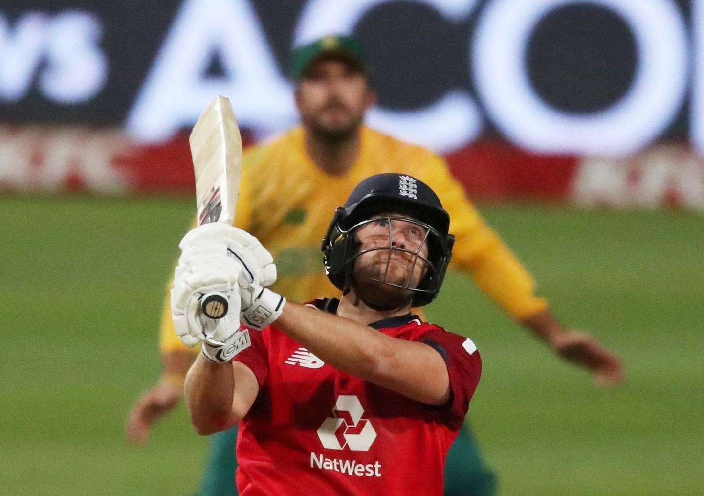 FILE PHOTO: Cricket - Third International Twenty20 - South Africa v England - Newlands Cricket Ground, Cape Town, South Africa - December 1, 2020  England's Dawid Malan hits a six REUTERS/Sumaya Hisham/File Photo