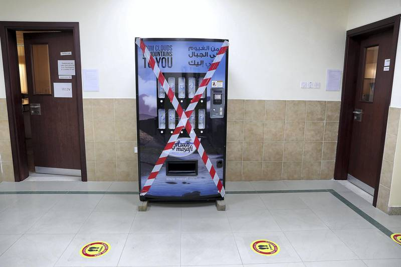 SHARJAH, UNITED ARAB EMIRATES , September 24 – 2020 :- Water dispenser machine closed for Covid 19 safety measure at the Victoria English School in Sharjah. New Covid safety setup in different areas of the school such as hand sanitizer, safety message, social distancing stickers pasted on the floor, disinfection tunnels installed at all the gates of the school. Schools in Sharjah are opening on 27th September.  (Pawan Singh / The National) For News. Story by Salam