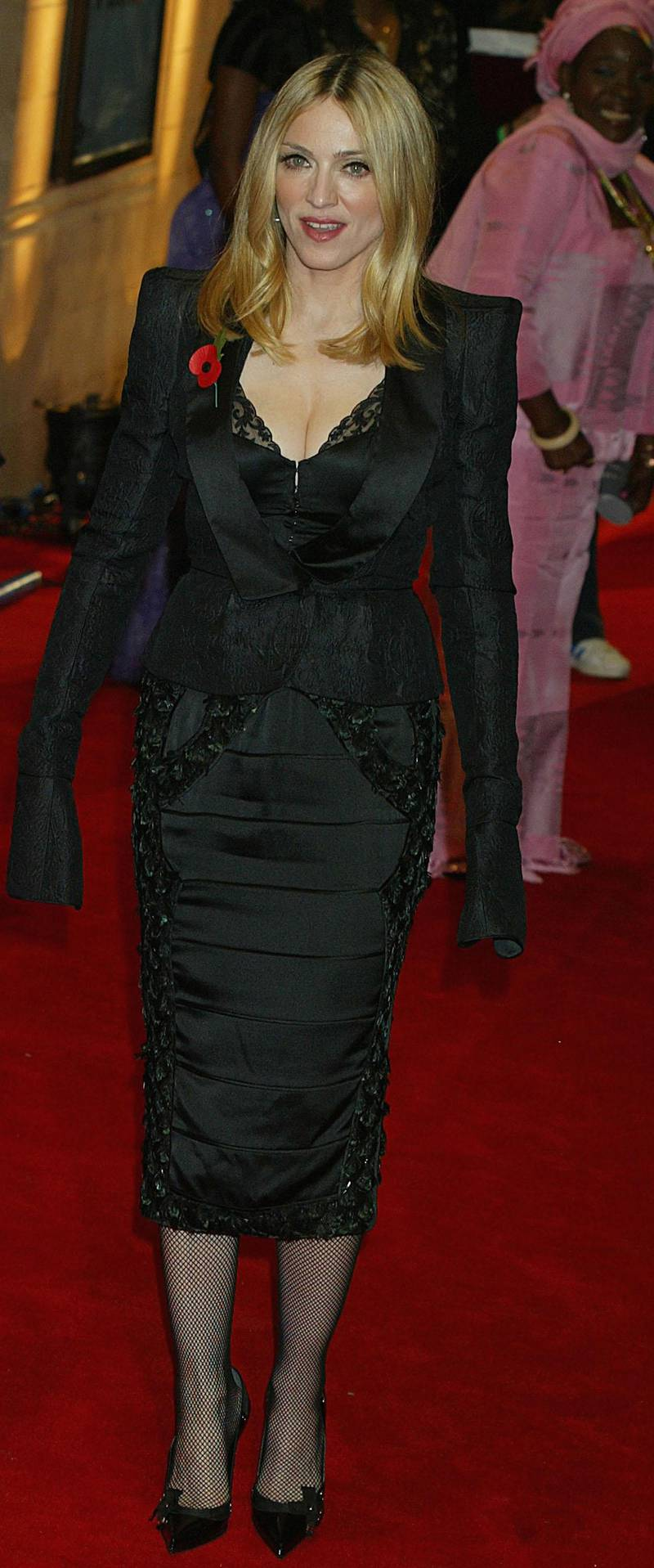 """LONDON -  NOVEMBER 11: Madonna arrives at the final of """"UK Music Hall Of Fame"""", the Channel 4 series looking at popular music from the 1950's to the 1990's, at the Hackney Empire on November 11, 2004 in London. Jamie Theakston has, for the past few weeks, been asking the public to vote on who should enter Channel 4's Hall Of Fame, and the winners are inducted this evening. (Photo by Jo Hale/Getty Images)"""