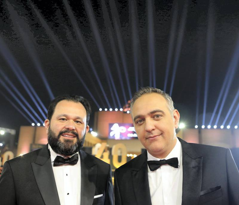"""Cairo International Film Festival executive director Omar Kassem (L) and President Mohamed Hefzy pose on the red carpet at the closing ceremony of the 40th edition of the Cairo International Film Festival (CIFF) at the Cairo Opera House in the Egyptian capital (CIFF) at the Cairo Opera House in the Egyptian capital on November 29, 2018. (Photo by PATRICK BAZ / Cairo International Film Festival / AFP) / RESTRICTED TO EDITORIAL USE - MANDATORY CREDIT """"AFP PHOTO / CAIRO INTERNATIONAL FILM FESTIVAL"""" - NO MARKETING - NO ADVERTISING CAMPAIGNS - DISTRIBUTED AS A SERVICE TO CLIENTS"""