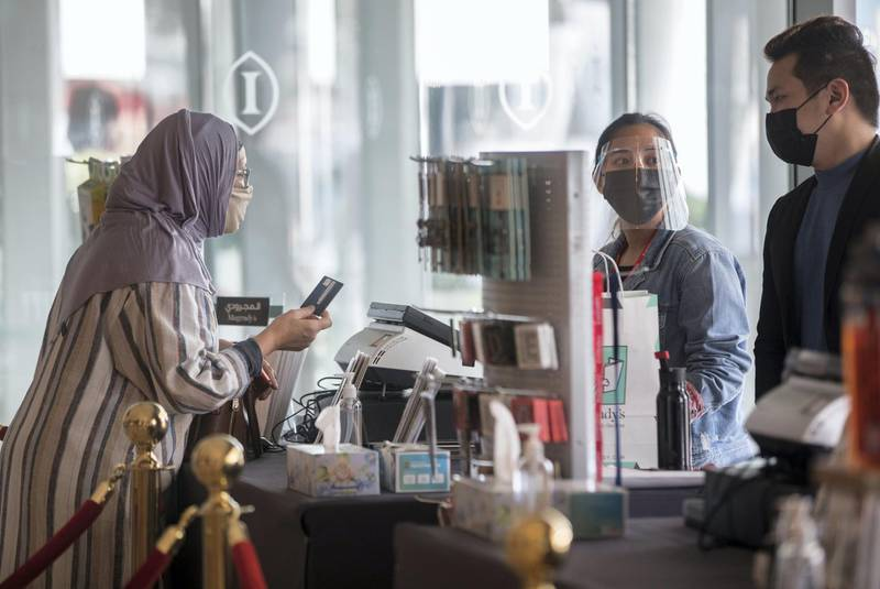 Duba, United Arab Emirates -  Book enthusiasts checking out books from different authors at the Emirates Airline Festival of Literature at InterContentinental Hotel Dubai Festival City.  Leslie Pableo for The National for Razmig's story