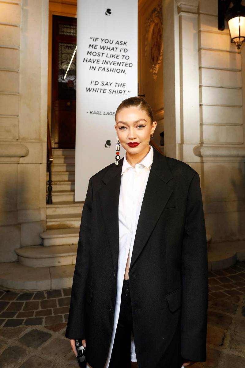 """PARIS, FRANCE - SEPTEMBER 25: Gigi Hadid attends the """"Tribute to the Karl Lagerfeld: The White Shirt Project"""" exhibition as part of Paris Fashion Week in Paris on September 25, 2019. (Photo by Julien M. Hekimian/Getty Images For Karl Lagerfeld )"""