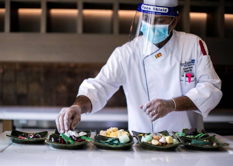 DUBAI, UNITED ARAB EMIRATES. 20 DECEMBER 2020. A chef prepares a gingerbread house at Radisson Blu Hotel, Dubai Deira Creek.(Photo: Reem Mohammed/The National)Reporter: Patrick RyanSection: