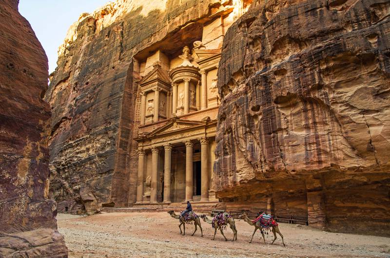the Treasury at Petra in the morning. Camels passing by. Courtesy Four Seasons
