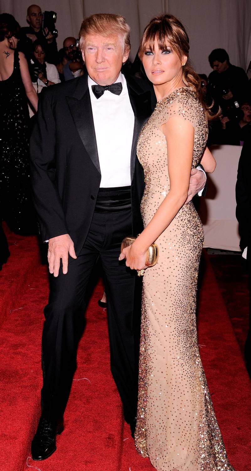 epa02714653 Real estate mogul Donald Trump (L), of the US, and his wife Melania Trump (R) arrive for the annual Costume Institute Gala Benefit at the Metropolitan Museum of Art in New York, New York, USA, 02 May 2011. The Met Gala 2011 celebrates the late British fashion designer Alexander McQueen and the opening of the exhibition 'Alexander McQueen: Savage Beauty', which runs from 04 May to 31 July 2011.  EPA/JUSTIN LANE