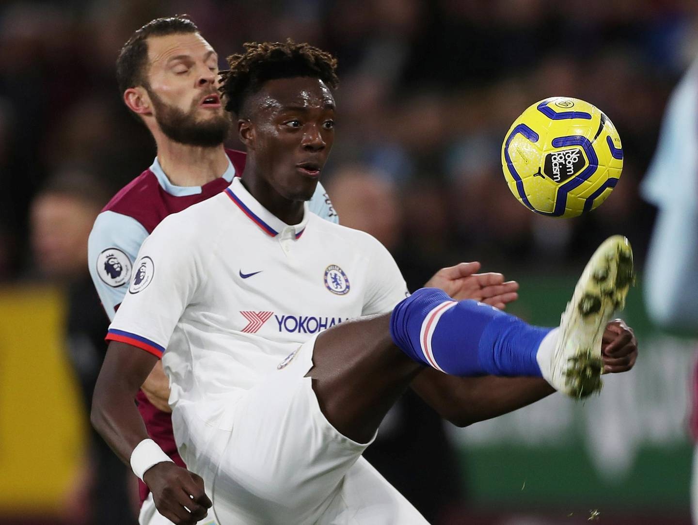 """Soccer Football - Premier League - Burnley v Chelsea - Turf Moor, Burnley, Britain - October 26, 2019  Chelsea's Tammy Abraham in action with Burnley's Erik Pieters   Action Images via Reuters/Lee Smith  EDITORIAL USE ONLY. No use with unauthorized audio, video, data, fixture lists, club/league logos or """"live"""" services. Online in-match use limited to 75 images, no video emulation. No use in betting, games or single club/league/player publications.  Please contact your account representative for further details."""