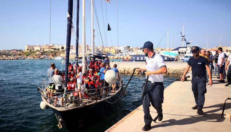 epa07699420 The Italian NGO Mediterranea Saving Humans' Alex migrant rescue ship carrying 41 migrants rescued off Libya Thursday docks at the port of Lampedusa, Sicily island, Italy, 06 July 2019. The boat carrying 41 migrants has docked in the Italian port despite a ban by Matteo Salvini, Italy's interior minister, who had vowed to block them.  EPA/ELIO DESIDERIO