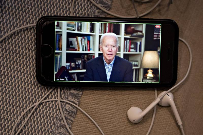Former Vice President Joe Biden, 2020 Democratic presidential candidate, speaks during a virtual press briefing on a smartphone in this arranged photograph in Arlington, Virginia, U.S., on Wednesday, March 25, 2020. During the livestreamed news conference today, Biden said he didn't see the need for another debate, which the Democratic National Committee had previously said would happen sometime in April. Photographer: Andrew Harrer/Bloomberg