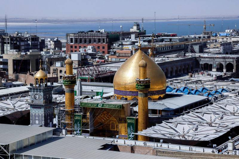 A picture taken on September 10, 2017 shows a view of the golden dome of Imam Ali's shrine in the Iraqi holy city of Najaf during Eid al-Ghadir, which commemorates the events of Ghadir al-Khumm, during which the Shiites believe that the Prophet Mohammed designated Ali as his successor. (Photo by Haidar HAMDANI / AFP)