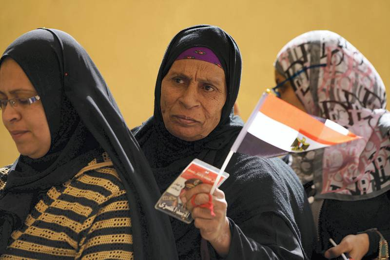 March 26, 2018- Cairo-- A woman stands in line to vote in the Gamiliya district in Cairo. Monday is the first day of voting in Egypt's presidential election. (Dana Smillie for The National)