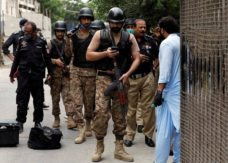 Paramilitary soldiers arrive at the site of an attack at the Pakistan Stock Exchange in Karachi June 29, 2020. REUTERS/Akhtar Soomro